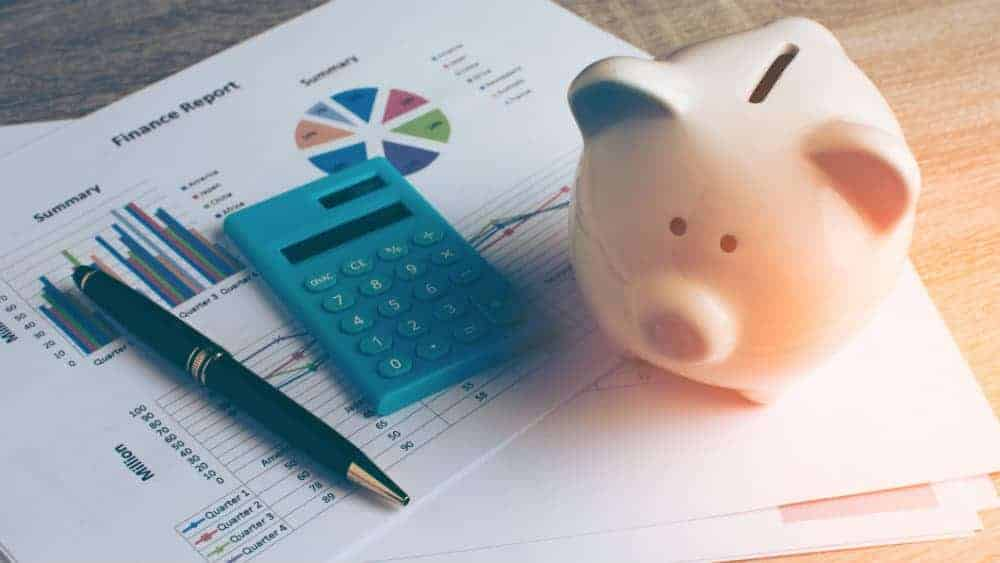 Piggy bank next to a financial report