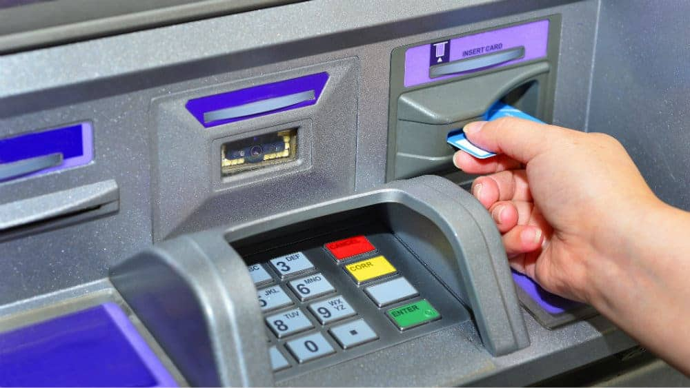 hand using ATM